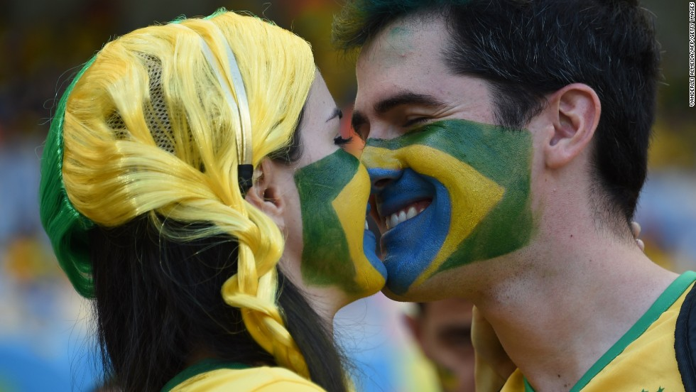 "Brazil fans kiss before the start of the game. <a href=""http://www.cnn.com/2014/06/26/football/gallery/world-cup-0626/index.html"" target=""_blank"">See the best World Cup photos from June 26</a>."