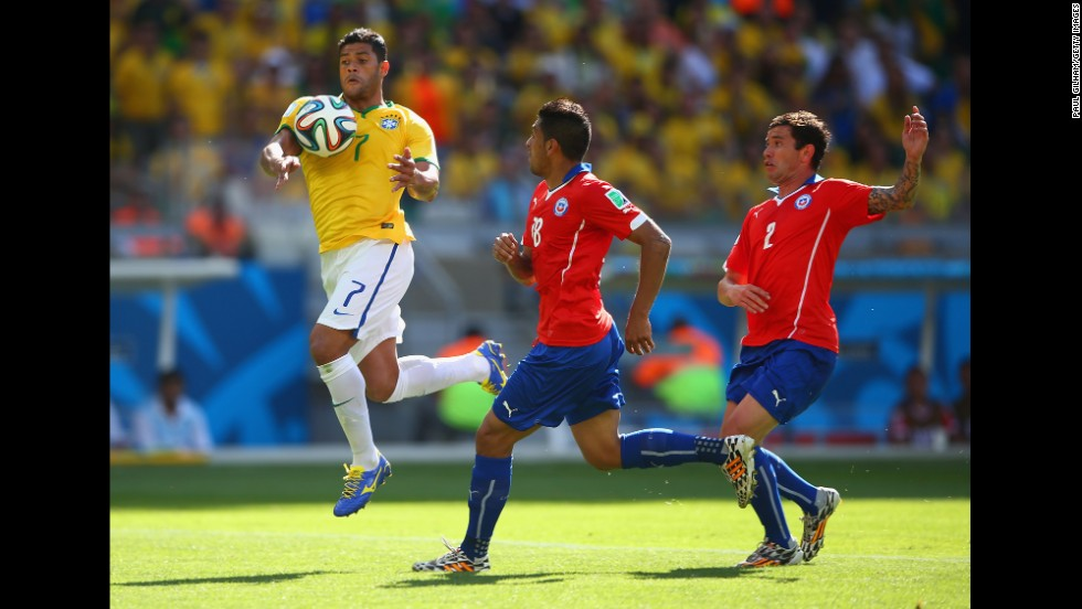 Hulk of Brazil handles the ball before scoring a goal that was taken back after being ruled a hand ball foul. The goal would have given the Brazilian team a lead on Chile with a score of 2-1.