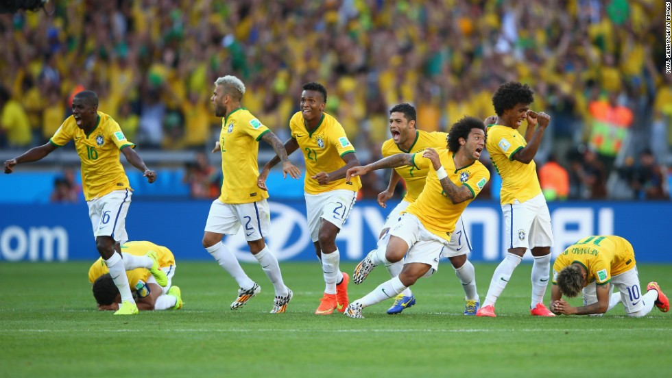 The Brazilian team celebrates after defeating Chile in a penalty shootout in Belo Horizonte, Brazil, on June 28. Regular and extra time ended with a score of 1-1, moving the game to a penalty shootout in which Brazil won 3-2.