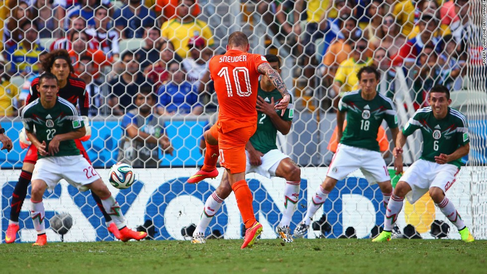 Wesley Sneijder of the Netherlands shoots and scores his team's first goal.