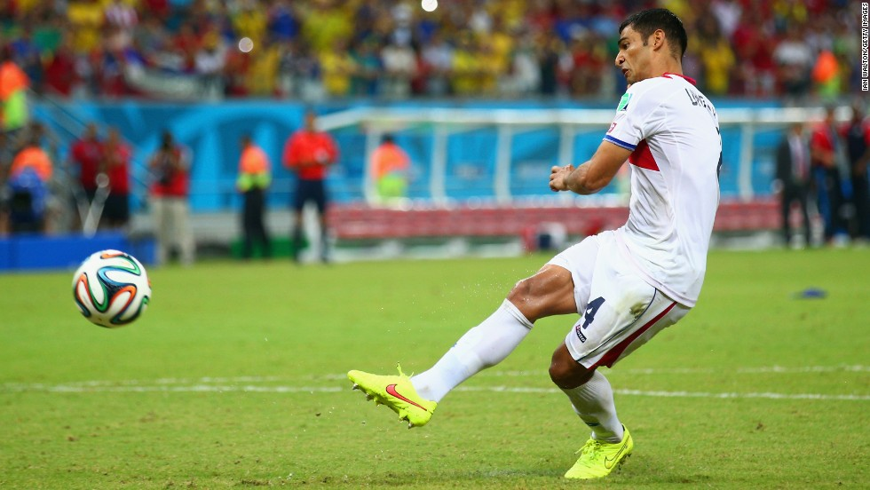 Michael Umana of Costa Rica shoots and scores a penalty kick to defeat Greece.