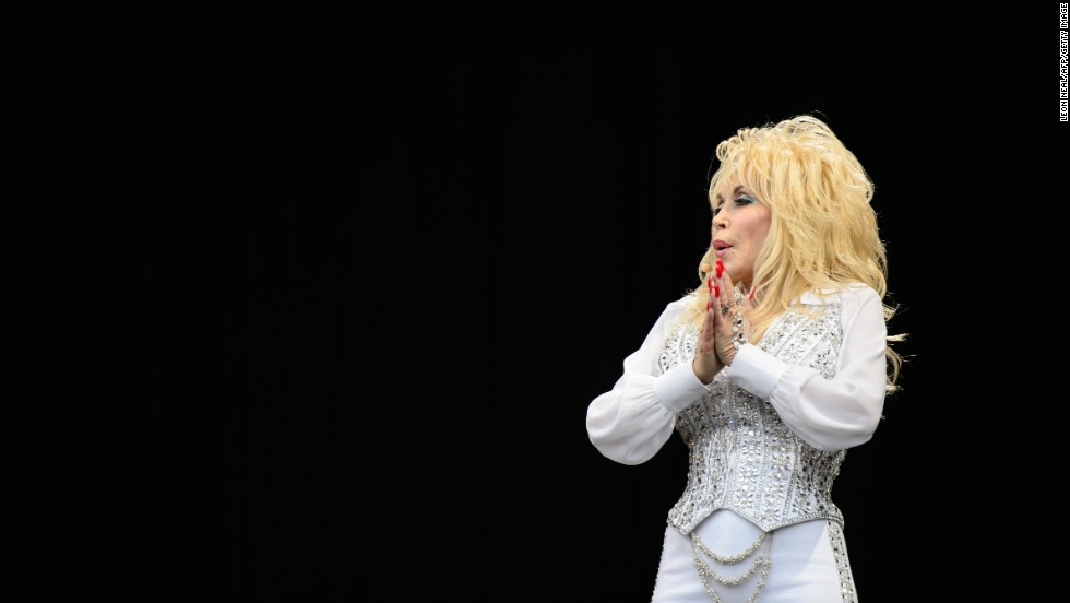 "JUNE 30 - GLASTONBURY, UK: Country music singer Dolly Parton performs in front of a large crowd during the ""Sunday Afternoon Legend's Slot"" of the Glastonbury festival, which is traditionally reserved for the biggest stars."