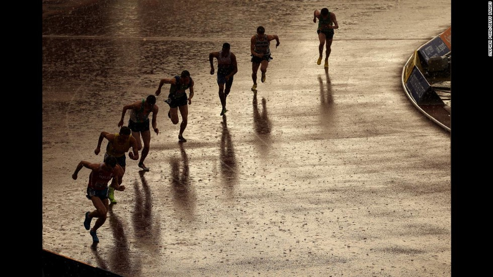 Athletes start an 800-meter race during heavy rain at the British Athletics Championships in Birmingham, England, on Friday, June 27.
