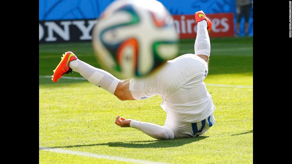 England's Wayne Rooney falls to the ground during a World Cup match against Costa Rica on Tuesday, June 24, in Belo Horizonte, Brazil. It ended 0-0, and Costa Rica advanced to the knockout stage of the tournament while England went home.