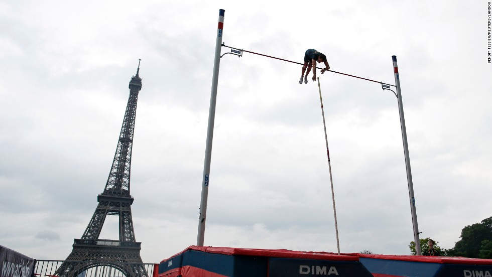 Olympic pole vault champion Renaud Lavillenie of France takes part in a pole vaulting exhibition Saturday, June 28, in Paris.