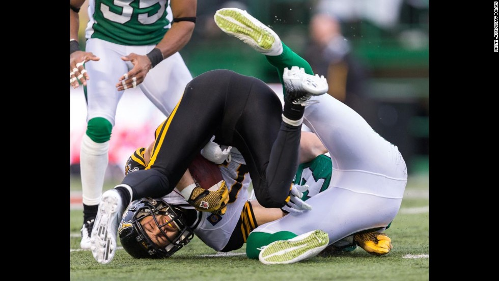 Luke Tasker of the Hamilton Tiger-Cats is tackled during a Canadian Football League game against the Saskatchewan Roughriders on Sunday, June 29, in Regina, Saskatchewan. The Roughriders, the defending CFL champions, opened their new season with a 31-10 victory.