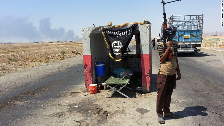 How does ISIS govern its territory?