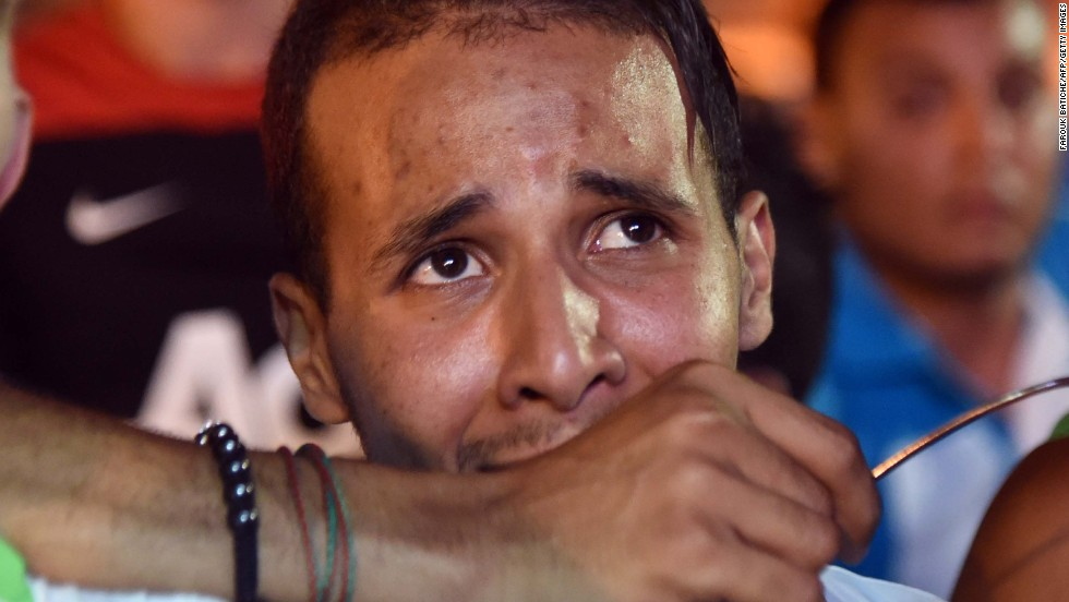 Disappointed fans of Algeria react during a public screening of the Germany match in Algiers, Algeria.