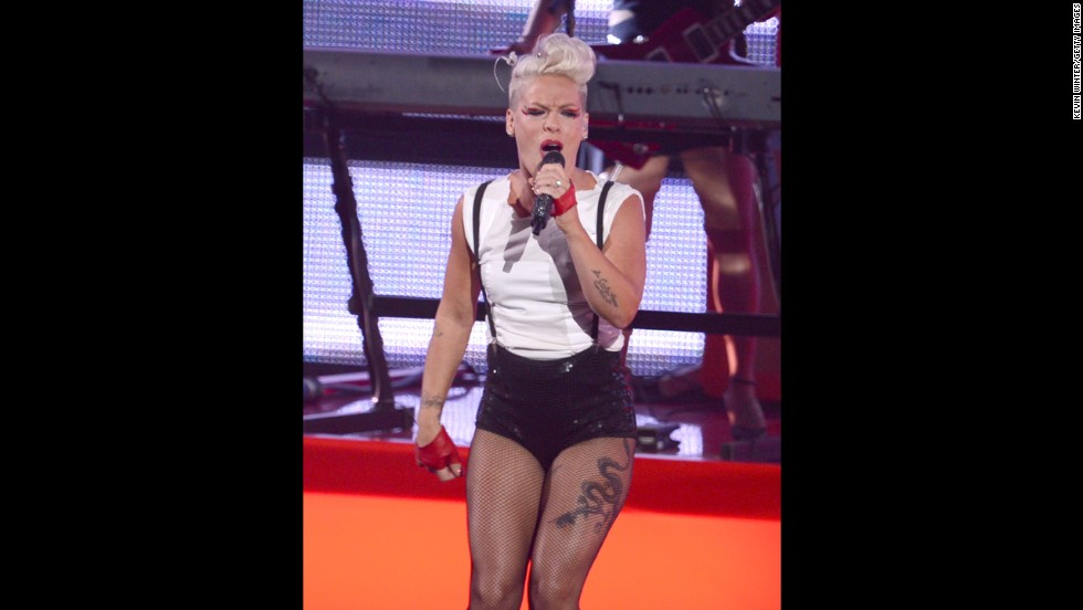 The real girl with the dragon tattoo, Pink, shows off her ink while performing at the 2012 MTV Video Music Awards.
