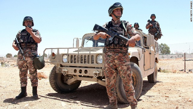 Jordanian soldiers stand guard near their vehicle as they secure the area near the Al-Karameh border point with Iraq on June 25, 2014 as Jordan reinforced its border with Iraq after Sunni Arab militants overran a crossing with Syria. Sunni insurgents led by the jihadist Islamic State of Iraq and the Levant (ISIL) overran swathes of land north and west of Baghdad this month sparking fears in Amman that they will take the fight to Jordan, which is already struggling with its own home-grown Islamists. AFP PHOTO/STR-/AFP/Getty Images