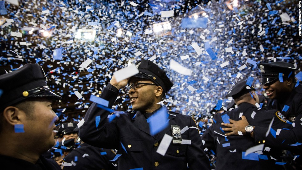 JULY 1 - NEW YORK, U.S.: New York Police Department's Class of 2014 celebrate at their graduation ceremony at Madison Square Garden. The NYPD has over 35,000 officers, with 604 graduates joining their ranks today.