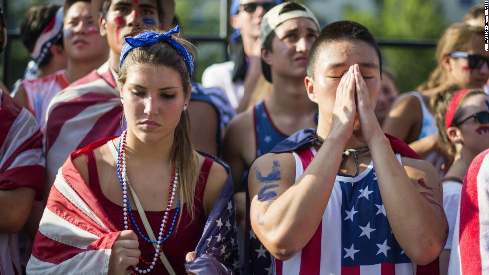 Fans in Washington react to the United States' loss to Belgium on July 1.