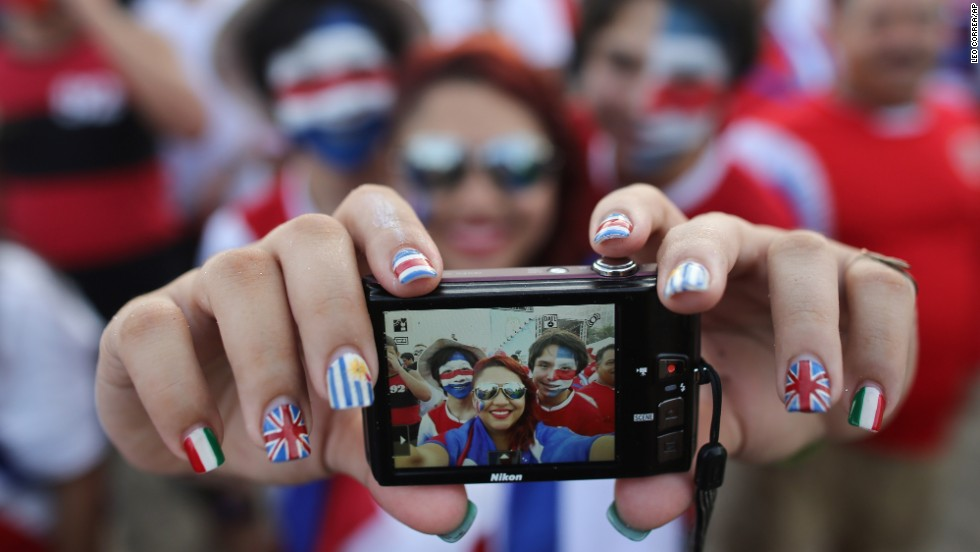 Costa Rica soccer fans in Rio de Janeiro pose for a selfie before watching their team's World Cup match against Greece on Sunday, June 29. Costa Rica won the match in a penalty kick shootout and advanced to the quarterfinals of the soccer tournament.
