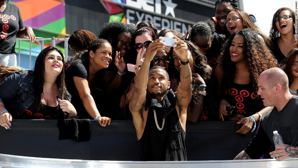 Recording artist Trey Songz snaps a selfie with fans in Los Angeles  during the BET Experience at L.A. Live on Friday, June 27.