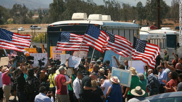Angry protesters forced three buses carrying undocumented immigrants to turn around Tuesday in Southern California.
