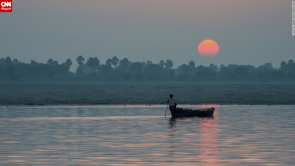 "<a href=""http://ireport.cnn.com/docs/DOC-953637"">Gary Ashley </a>said this sunrise over India's Ganges River was ""a sight that remained etched in his mind."" He captured this image during a late summer vacation to the ancient spiritual center of Varanasi."