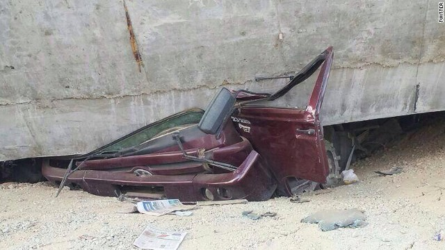 Twitter photos of a car crushed under a bridge in Brazil