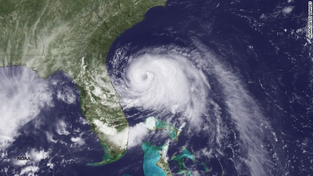 UNITED STATES - JULY 2: In this handout provided by the National Oceanic and Atmospheric Administration (NOAA) from the GOES-East satellite, Tropical Storm Arthur travels up the east coast of the United States in the Atlantic Ocean pictured at 19:45 UTC/GMT on July 2, 2014. According to reports, Arthur, now with maximum sustaned winds of 70 mph, has begun moving steadily northward is expected to strike the North Carolina Outer Banks over the Fourth of July holiday. Arthur is expected to become a hurricane by July 3.   (Photo by