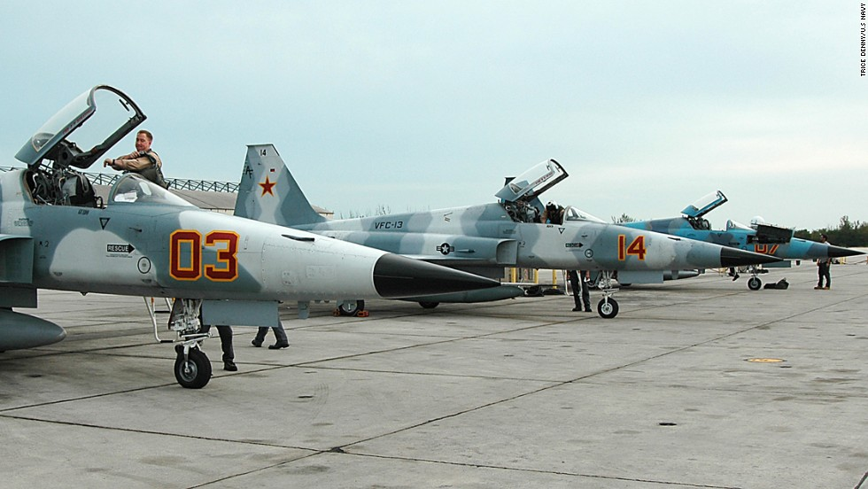 Pilots perform daily flight checks on their F-5E/F Tiger aircraft in Key West, Florida, on January 7, 2005. The Vietnam-era aircraft -- one of several offshoots of the original Northrup F-5s that went into service in the early 1960s -- is used to simulate adversary aircraft in training.