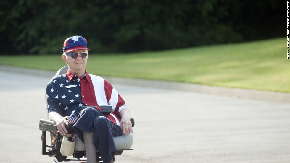 "Walter Lindsay plays Whitney Houston's rendition of ""The Star-Spangled Banner"" during a golf-cart parade in Tyler, Texas."