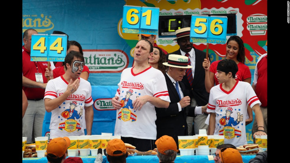 Chestnut, center, reacts next to fellow competitors Tim Janus, left, and Matt Stonie after the competition.