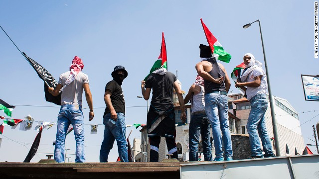 Clashes break out between Israeli police and Palestinian youths during the noon Ramadan prayer in Ras Al Amud neighbourhood ahead of the funeral ceremony of Muhammad Abu Kdear on July 4 2014 in Jerusalem, Israel.