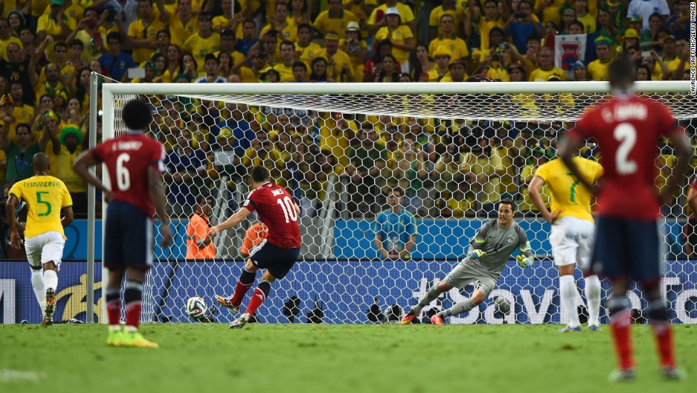 Colombia's James Rodriguez scores a second-half penalty against Brazil during a World Cup quarterfinal match Friday, July 4, in Fortaleza, Brazil. But Brazil held on to win 2-1 and advance to the semifinals.