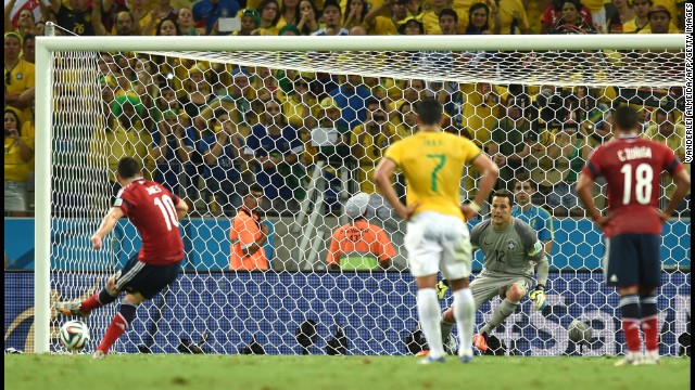 Colombia's midfielder James Rodriguez (L) shoots and scores a penalty during the quarter-final football match between Brazil and Colombia at the Castelao Stadium in Fortaleza during the 2014 FIFA World Cup on July 4, 2014.