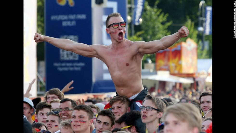 Fans of Germany celebrate at the Brandenburg Gate in Berlin while watching the quarterfinal victory over France on July 4.
