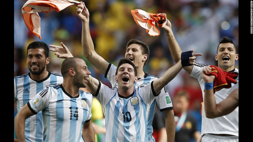 Argentina forward and captain Lionel Messi, center, celebrates with teammates after winning their quarterfinal match against Belgium on July 5.