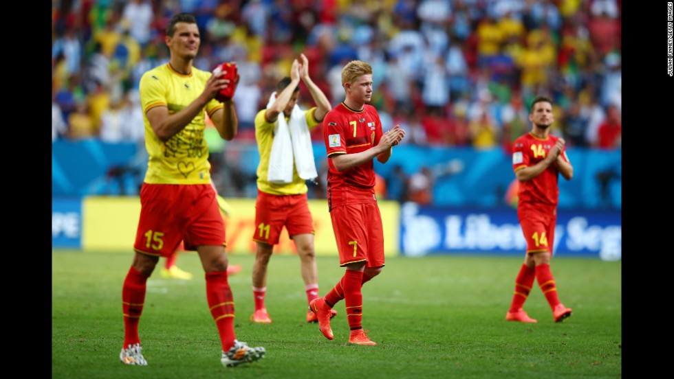 Daniel Van Buyten, left, and Kevin De Bruyne of Belgium acknowledge the fans after their loss 1-0 loss to Argentina.