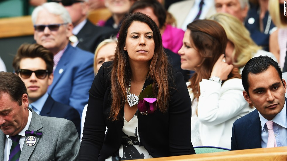 Nearby, reigning champion (although not for long) Marion Bartoli casts her eyes across proceedings.