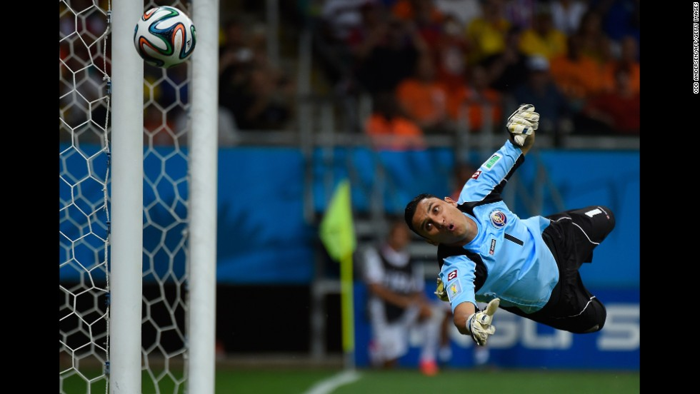 Costa Rica goalkeeper Keylor Navas dives for the ball.