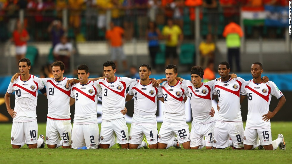 Costa Rica players line up for a penalty shootout after extra time ended with no score.