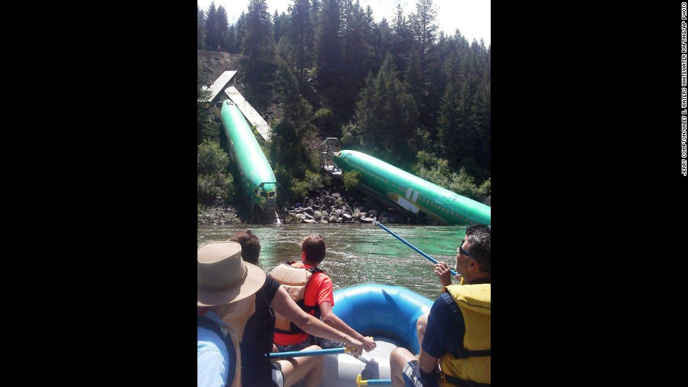 Rafters pass the fuselages as they go down the Clark Fork River near a section called Mermaid Rock.