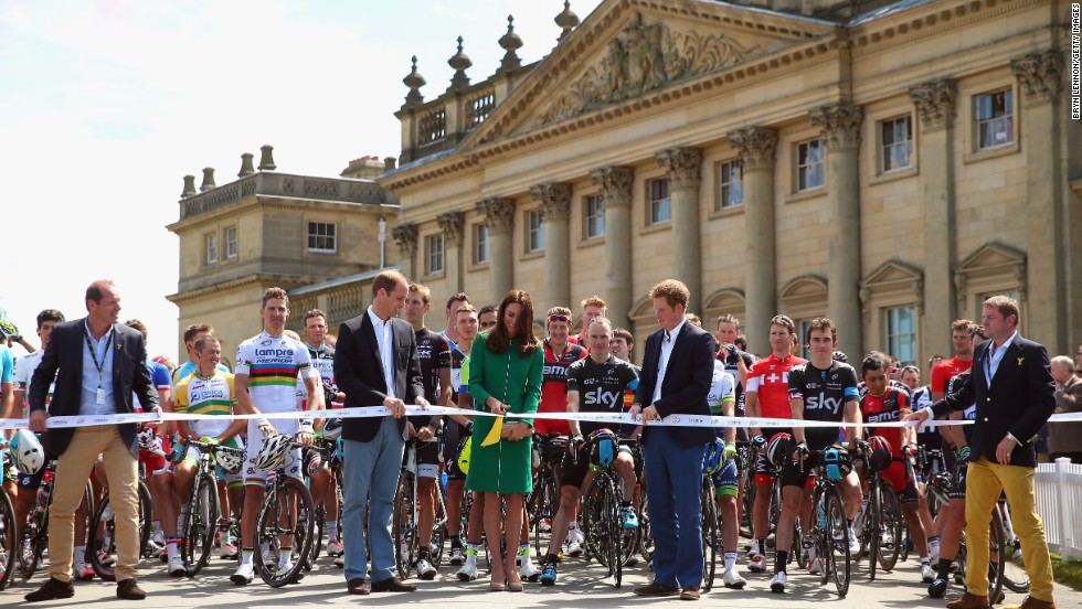 The Duke and Duchess of Cambridge inaugurate the opening stage of the Tour by ceremoniously cutting the ribbon in front of the racers.
