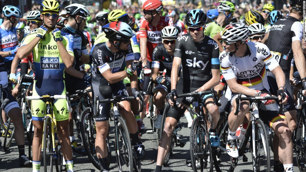 Contador, Mark Cavendish, Chris Froome and Andre Greipel all stand at the front of the pack waiting for the first stage of the Tour to begin. Cavendish's race ended later that day with a crash in Harrogate.