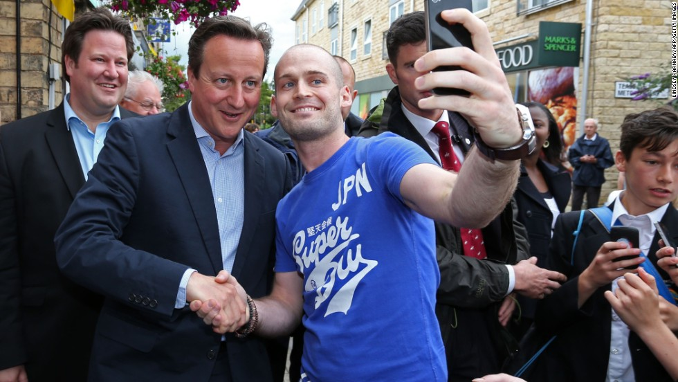 British Prime Minister, David Cameron, gets involved in the 'selfie' trend as he poses with a Tour de France fan.
