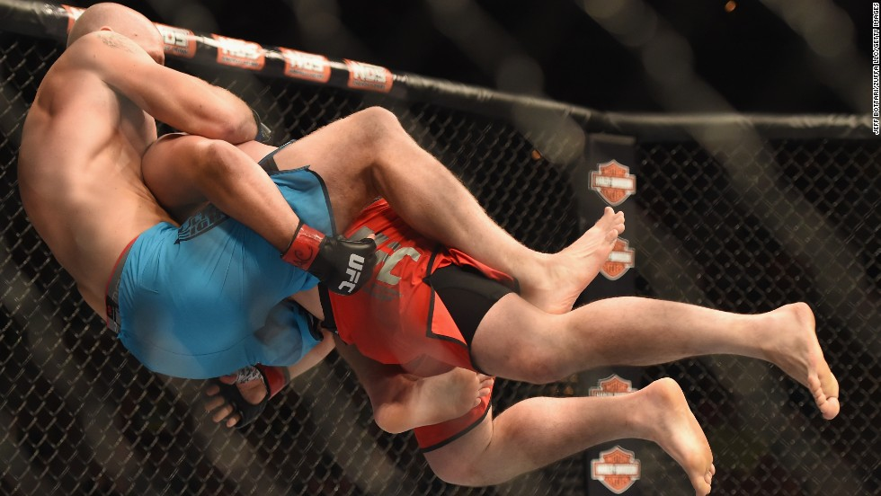 "Patrick Walsh, right, takes down Daniel Spohn in their light-heavyweight fight held Sunday, July 6, in Las Vegas. Walsh won by unanimous decision in a bout between two contestants from ""The Ultimate Fighter"" television show."