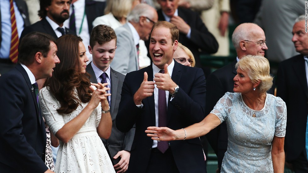 Britain's Prince William gives two thumbs up as he and his wife, the Duchess of Cambridge, watch tennis Wednesday, July 2, at Wimbledon.
