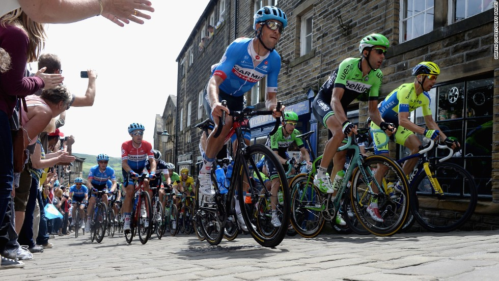 The pack rides up the high street in Haworth, the home of the Bronte sisters, who penned a series of literary masterpieces in the 19th century.