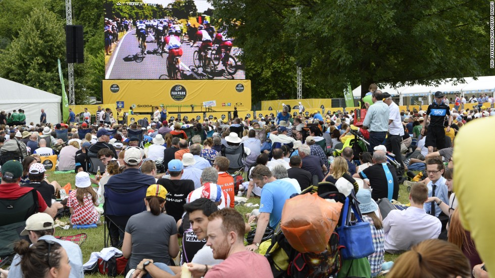 Fans gathered at the 'Fan Park' in Green Park look at a  giant screen as the 155 km third stage takes place. The third stage began in Cambridge and ended in London.