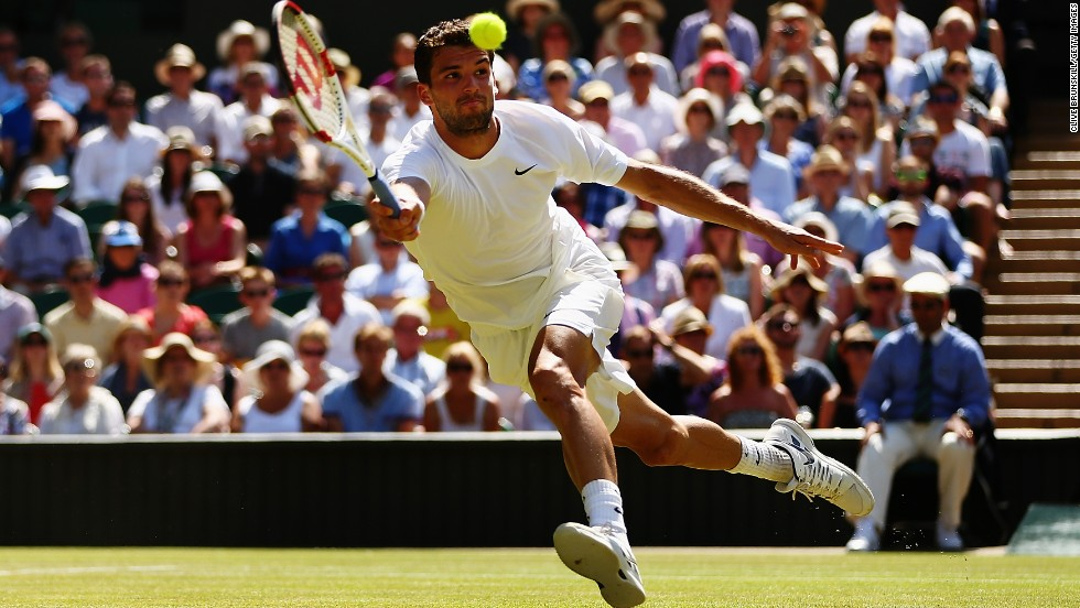 Grigor Dimitrov reaches for a return during his Wimbledon semifinal against Novak Djokovic on Friday, July 4. Djokovic won in four sets.