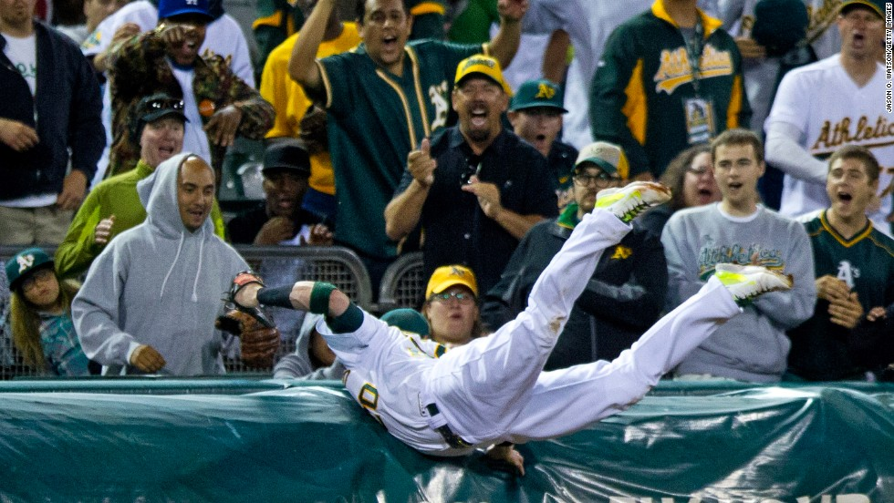 Oakland's Josh Donaldson dives into the tarp near third base to catch a foul ball during a home game against Toronto on Saturday, July 5. A day later, Donaldson was named to the All-Star team for the first time in his career.
