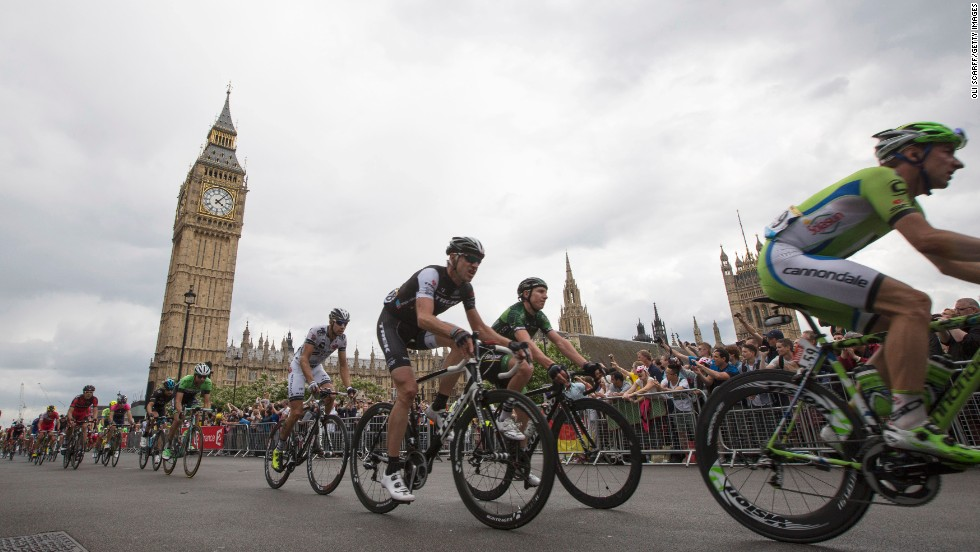 The crowds cheer on as the cyclists pass through Parliament Square and the Big Ben on their tour through London.