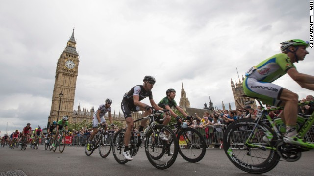 The crowds cheer on as the cyclists pass through Parliament Square and the Big Ben in their tour through London.