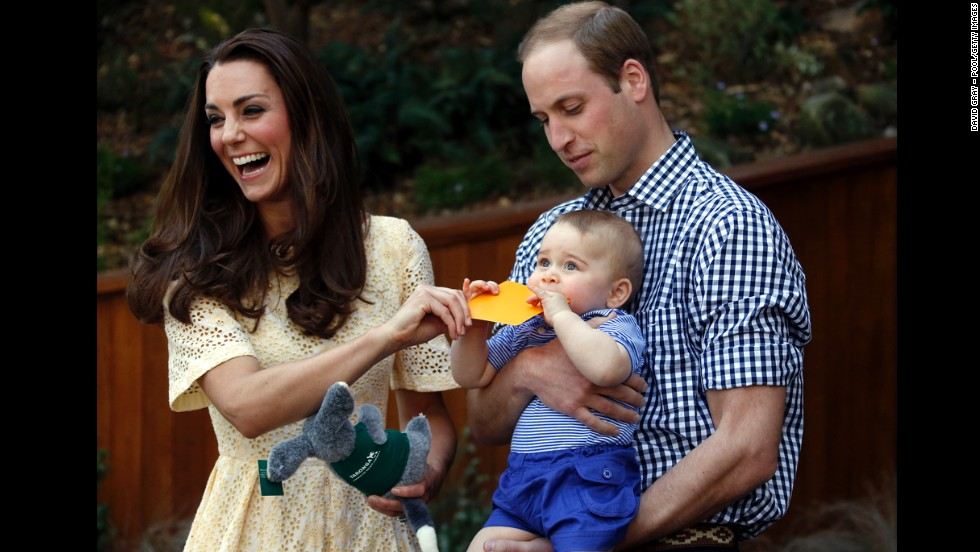 Catherine and William react as their son bites a small present at the bilby enclosure of Sydney's Taronga Zoo in April 2014. One of the zoo's bilbies was renamed George in honor of the young prince.