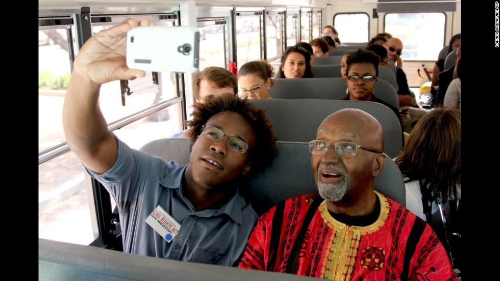 "Former ""Freedom Rider"" John Moody, right, and college student Dennis Johnson ride through Washington on Wednesday, July 2, to commemorate the 50th anniversary of the signing of the Civil Rights Act. The Freedom Riders were an interracial group of civil rights activists who risked their lives by riding passenger buses together through the segregated Deep South."