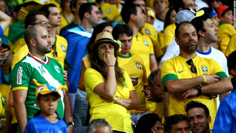 Brazil fans look dejected at the stadium.