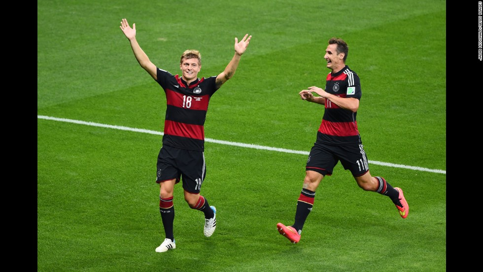 Toni Kroos of Germany, left, celebrates scoring the third goal of the game.